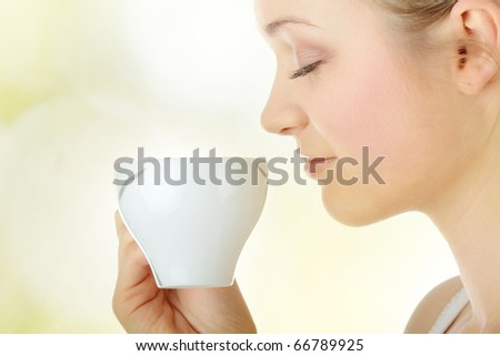 Young attractive blond woman drinking coffee