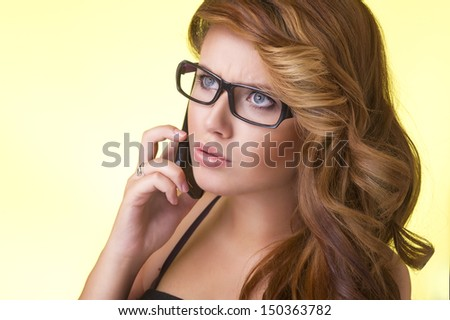 Young attractive blonde woman speaking on mobile phone