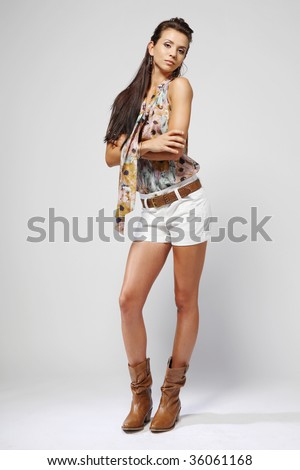Young attractive brunette fashion model.