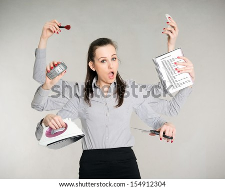young attractive brunette with six arms multitasking her work