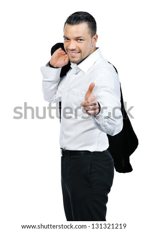 Young attractive business man pointing at you and smiling, isolated on white background