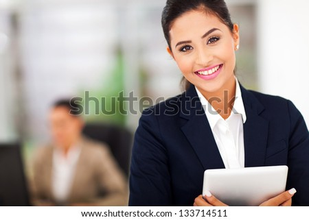 young attractive business woman holding a tablet computer