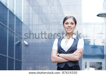 Young attractive business woman over modern background