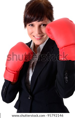 young attractive business woman with boxing gloves are ready for battle