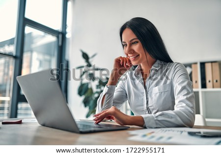 Young attractive business woman working in modern office. Foto stock ©