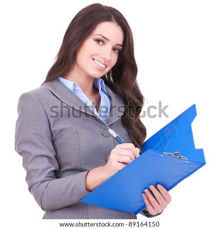 Young attractive business woman writing on clipboard, isolated on white background
