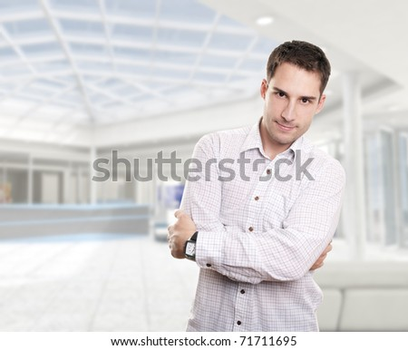 Young attractive businessman in corporate building