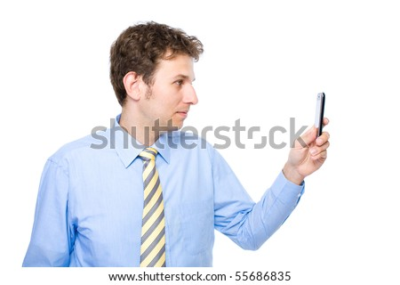 young attractive businessman taking photo with his smartphone, mobile, studio shoot isolated on white background