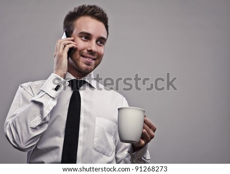 Young attractive businessman with white cap