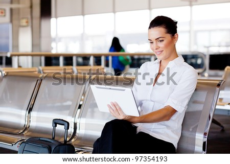 young attractive businesswoman using tablet computer at airport