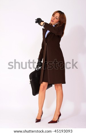 Young attractive businesswoman watching the clock