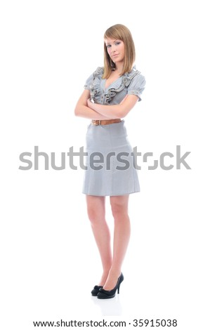 Young attractive businesswoman with crossed arms, full length portrait, isolated on white