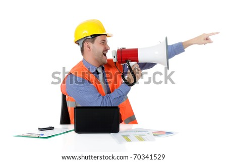 Young attractive caucasian man architect with helmet at office with laptop, yelling at megaphone. Studio shot. White background.