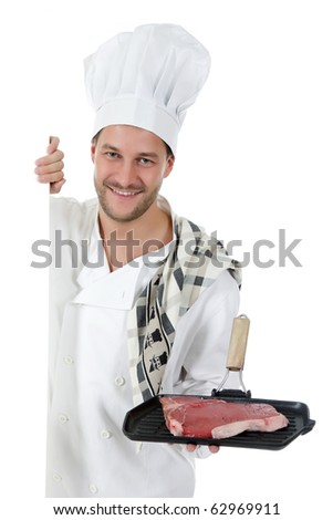Young attractive chef caucasian male with hat and white uniform showing a grill with a tender t-bone steak. Studio shot. White background.