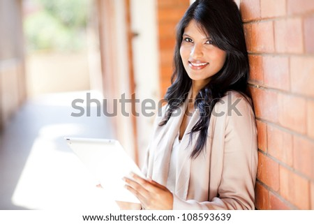 young attractive college girl using a tablet computer