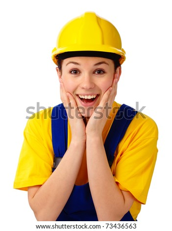Young attractive construction girl holding her face in astonishment, isolated over white