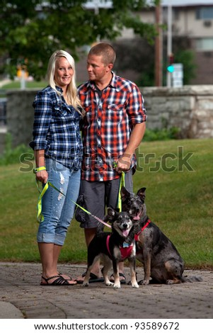 Young attractive couple and their dogs