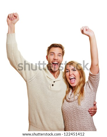 Young attractive couple cheering together with their clenched fists