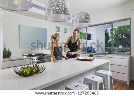 Young attractive couple in modern kitchen