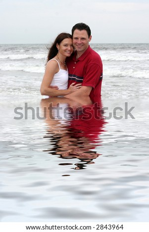 young attractive couple in water