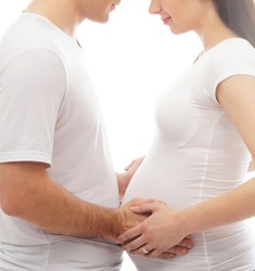 Young attractive couple: pregnant mother and happy father