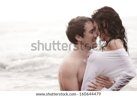 Young attractive couple sharing a moment at the beach