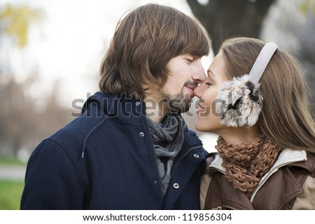 Young attractive couple together outdoors
