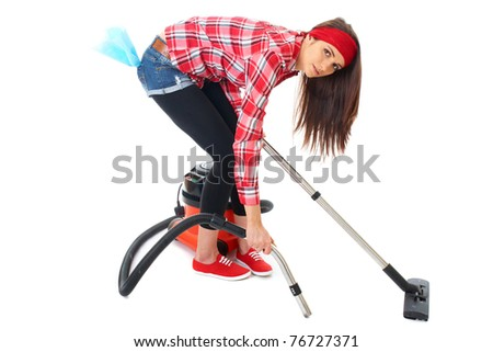 young attractive female cleaner in red shirt use vacuum cleaner, isolated on white background