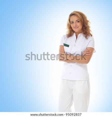 Young attractive female doctor isolated over blue  background