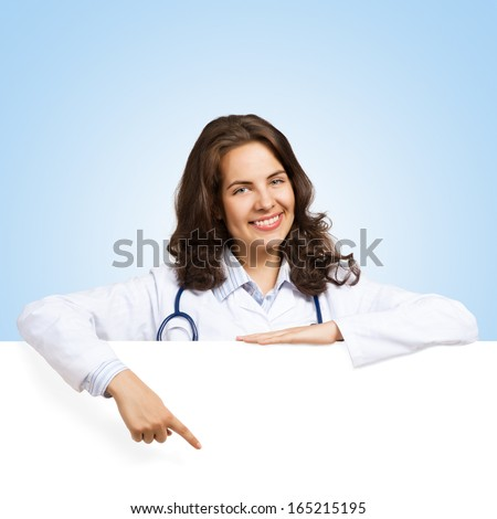 Young attractive female doctor put her hands on the blank banner, points at a place for text