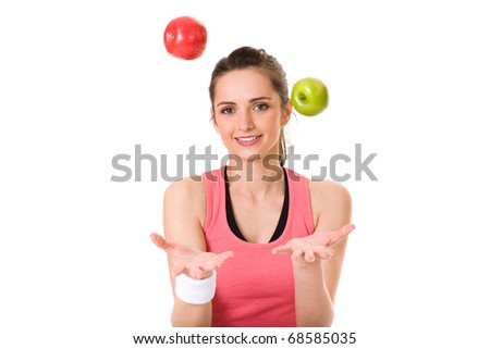 young attractive female in fitness top, with green and red apple, studio shoot isolated on white