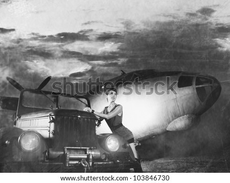 Young attractive female soldier with the plane and car (WARNING! There are noise, dust and scratches on the image)