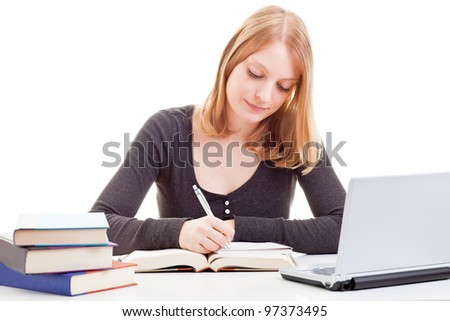 Young attractive female student taking notes from open book isolated on white background - stock photo