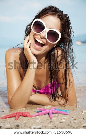 young attractive female sunbathing and having fun