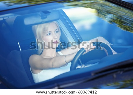 Young attractive girl behind the wheel