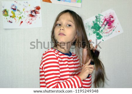 young attractive girl doing her hair #1195249348