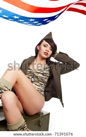 Young attractive girl dressed in old battle coat sitting . Vintage style studio shot.