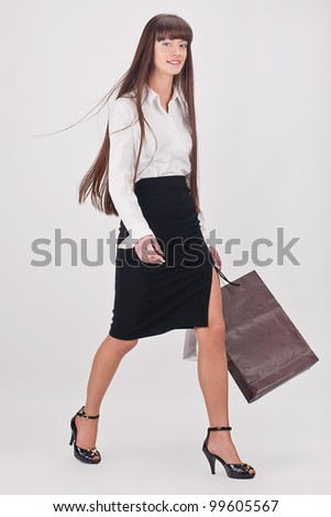 Young attractive girl enjoys a large number of purchases