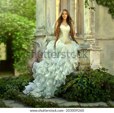 Young attractive girl Fairy tale with princess in old medieval garden