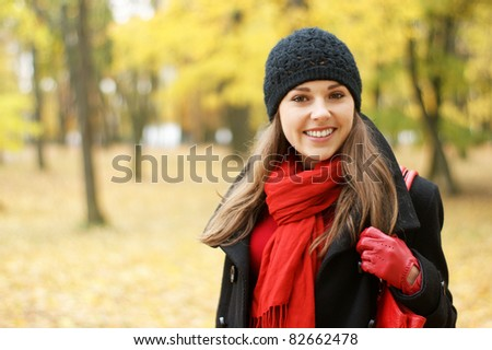 Young attractive girl in autumn park