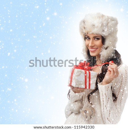 Young attractive girl in Christmas style over the background with snow
