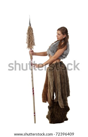 Young attractive girl in costume of savage woman with a spear
