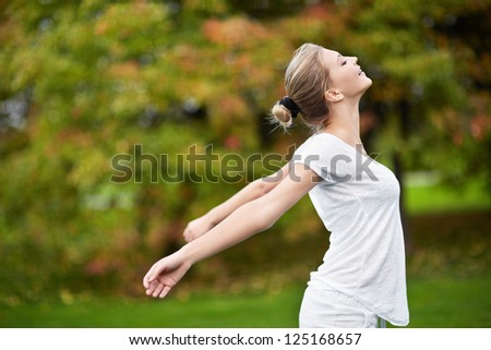 Young attractive girl in park