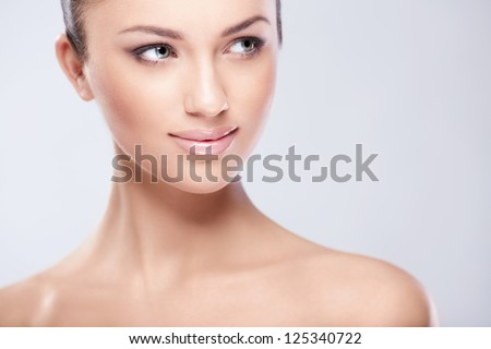 Young attractive girl in studio