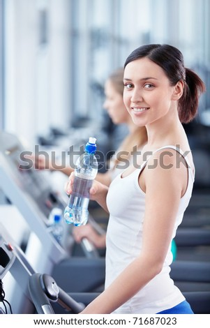 Young attractive girl in the fitness club