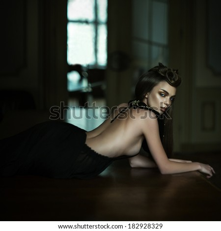 Young attractive girl in the image of princess in rich interior Grain added