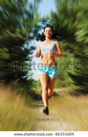 Young attractive girl running on the morning (motion blur)