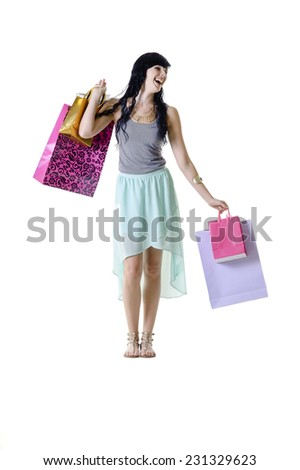 Young attractive girl with colorful shopping bags isolated on white background #231329623
