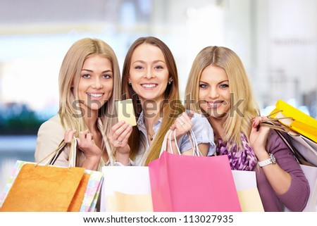 Young attractive girls with shopping bags and credit card