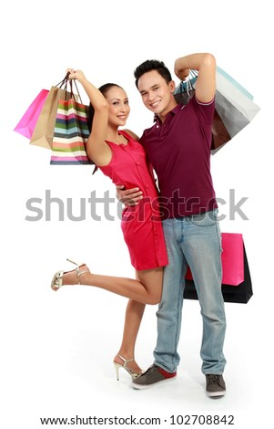 young attractive happy couple having fun with shopping bags